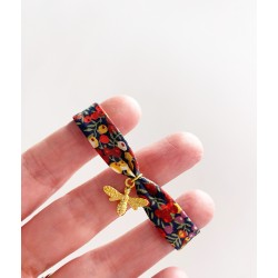 Pulsera mini estrella dorada flores